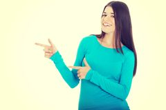 Beautiful casual woman pointing on copy space. Beautiful casual woman pointing on copy space Stock Photography