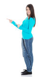 Beautiful casual woman pointing on copy space. Royalty Free Stock Photography