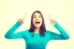 Beautiful casual woman pointing on copy space. Stock Photography