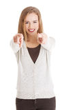 Beautiful casual woman pointing on you, advertising. Royalty Free Stock Image