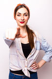 Beautiful casual woman pointing on you. On white Stock Photography