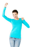 Beautiful casual woman with raised fists. Royalty Free Stock Images