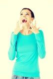 Beautiful casual woman screaming, looking up. Stock Photos
