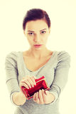 Beautiful casual woman showing her empty wallet. Stock Photos