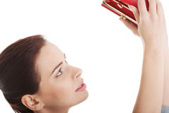 Beautiful casual woman showing her empty wallet. Stock Image
