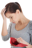 Beautiful casual woman showing her empty wallet. On white Royalty Free Stock Image