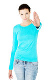 Beautiful casual woman showing stop gesture. Stock Images
