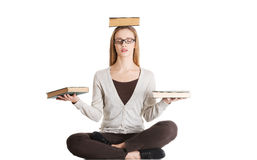 Beautiful casual woman sitting with books on palms and head, doi Royalty Free Stock Images