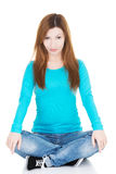 Beautiful casual woman sitting and holding her knees. Royalty Free Stock Photo