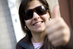 Beautiful casual woman with thumbs up Royalty Free Stock Photography