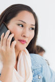 Beautiful casual woman using mobile phone in office Royalty Free Stock Photo