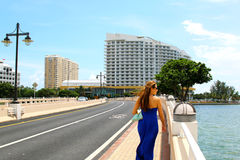 Beautiful casual woman walking in downtown Miami Royalty Free Stock Image