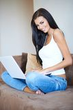 Beautiful casual young woman using a laptop Stock Image