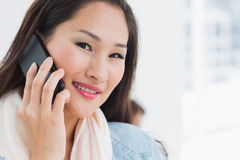 Beautiful casual young woman using mobile phone in office Stock Photo