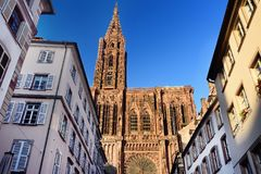 Beautiful Cathedral Notre Dame of Strasbourg in sunset light. Alsace, France. Beautiful Cathedral of Our Lady Notre Dame of Strasbourg and old buildings, sunset royalty free stock photo