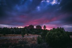 Cathedral Rock Sunset. Beautiful Cathedral Rock formation with dramatic pink and purple sky at sunset, Sedona, Arizona Stock Photo