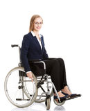 Beautiful caucasain business woman sitting on wheelchair. Stock Photo
