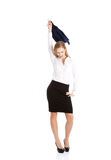 Beautiful caucasain business woman takes off her jacket. Stock Photo