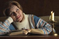 Beautiful Caucasian bliss elderly woman sitting Stock Photography