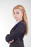 Beautiful Caucasian blond businesswoman with folded hands Stock Images