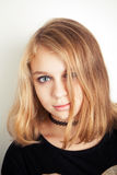 Beautiful Caucasian blond teenage girl in black Royalty Free Stock Photos