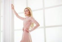 Beautiful caucasian blonde girl in gorgeous dress Stock Photo