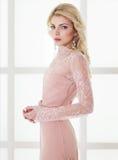 Beautiful caucasian blonde girl in gorgeous dress Stock Image