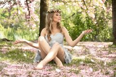 Beautiful caucasian blonde woman in garden. Royalty Free Stock Images