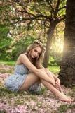 Beautiful caucasian blonde woman in garden. Stock Photography