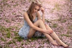 Beautiful caucasian blonde woman in garden. Stock Image