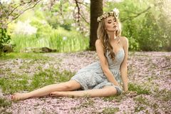 Beautiful caucasian blonde woman in garden. Stock Photos