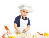 Beautiful caucasian boy making a cake Royalty Free Stock Photos