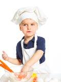Beautiful caucasian boy making a cake Royalty Free Stock Image
