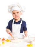 Beautiful caucasian boy making a cake Royalty Free Stock Photography