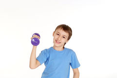 Beautiful Caucasian boy standing with dumbbells Royalty Free Stock Photography