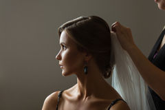 Beautiful caucasian bride getting ready for the wedding Stock Images