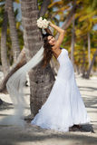 Beautiful caucasian bride posing at a tropical beach. Beautiful asian bride posing at an exotic location Stock Photography