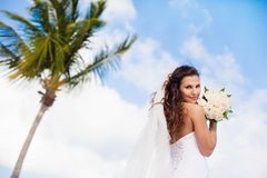 Beautiful caucasian bride posing at a tropical beach Stock Photos