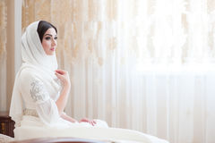 Beautiful caucasian bride in traditional dress Stock Image