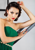 Beautiful caucasian brunette woman in gorgeous green dress with Stock Images