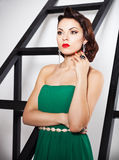 Beautiful caucasian brunette woman in gorgeous green dress with Stock Photos