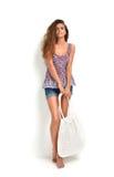 Beautiful caucasian brunette woman walking with big modern beach Stock Images