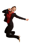 Beautiful caucasian business female jumping for with joy on cel Stock Photos