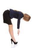 Beautiful caucasian business woman bending down. Stock Photo