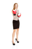 Beautiful caucasian business woman with boxing gloves. Royalty Free Stock Photos