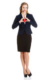 Beautiful caucasian business woman at call center holding heart. Stock Image