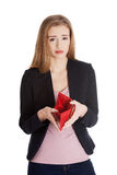 Beautiful caucasian business woman checking her empty red wallet. Isolated on white Stock Photography
