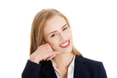 Beautiful caucasian business woman encourages to call her. Royalty Free Stock Images