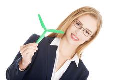 Beautiful caucasian business woman with green propeller. Stock Image