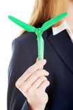 Beautiful caucasian business woman with green propeller. Stock Photos